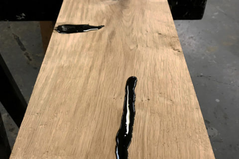treating the wood with resin